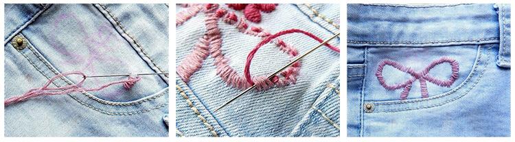 Процесс вышивки на джинсах
